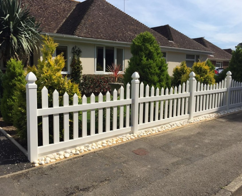 Plastic Fencing in Front of a Family House